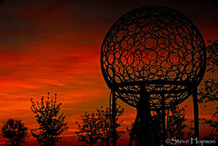 Pollen Grain Sculpture (Steve Hopson) Tags: light sunset sculpture orange usa silhouette metal clouds austin landscape geotagged us spring airport globe nikon texas earth silhouettes trellis explore sphere austintexas publicart pollen orangelight sunsetlight sculptor goldenhour allergy metalsculpture allergies landscapearchitecture goldenlight rvi interestingness96 robertmuellerairport landscapearchitect earthglobe i500 levack d700 pollengrain nikond700 muellerredevelopment muellerneighborhood robertmuellerinternationalairport chrislevack thesplintergroup artunlimitedperiod