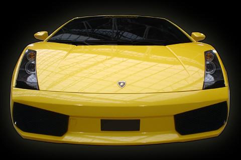 lamborghini wallpaper yellow. Yellow Lamborghini on black