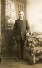 William Relph poses in a photographer's studio in 1917 (lovedaylemon) Tags: man vintage bench studio found image cork seat bark backdrop williamrelph