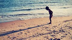 A boy and his shadow (jami_lee) Tags: ocean boy shadow beach kid sand child shoreline wave curious
