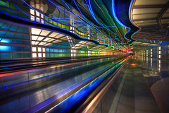 Psychadelic Tunnel at O'Hare (Greg Benz Photography) Tags: photography airport rainbow ohare peoplemover neonlights ord hdr chicagoairport unitedairlines hdrtechnique chicagohdr carbonsilver chicagoneon