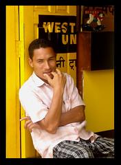 Shy Guy (nida shams) Tags: door travel nepal horse guy yellow point toy wooden asia shoot union shy panasonic western shops 2008 bakhtapur