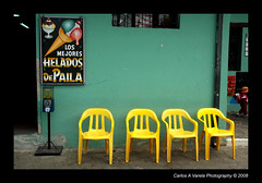 Yellow Plastic Chairs (Carlos A Varela) Tags: park green yellow quito ecuador chairs plastic theme equator mitaddelmundo