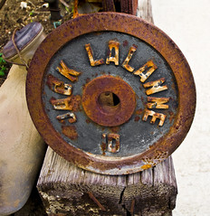 Ten Pounds (Maureen Bond) Tags: vintage circle outside 10 decoration rusty plate icon round ten weathered heavy fitness weight pounds vitality jacklalanne thejuicer maureenbond restinpeacejack thegymsuite