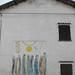 Ciò che resta; 1996. Ceramica smaltata policroma, cm 260x260.<br /> Maglione, Via Cigliano.<br />