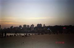 City at Dusk (Jennifer Kumar) Tags: sunset beach bombay mumbai negativescan queensnecklace india1998 indiasunset
