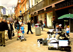 one man (& 2-dog) band (Harry Halibut) Tags: street city musician dogs mouth sheep drum guitar centre leeds organ pedestrians busker spectators harmonica allrightsreserved briggate listeners onemanband urbanarea leeds080502083a andrewpettigrew