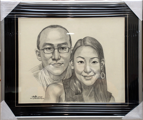 Couple portraits in pencil with matt silver frame and v-grrove border