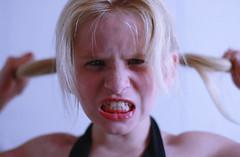 Kids (Deana Steere) Tags: blue girl canon hair eos dof teeth pigtails stress cringe supershot 40d canoneos40d deanasteere