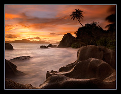 Silhouettes by Michael Anderson (AndersonImages) Tags: ocean africa travel sunset beach clouds digital sunrise islands la michael bravo rocks paradise surf indian peaceful victoria sensual hasselblad anderson shore palmtree tropical medium format seychelles tropics mahe digue praslin michaelanderson h2d