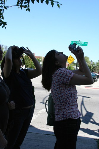 Girls photographing Hot Doug's Sign
