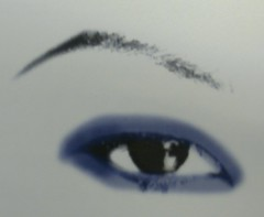 To DEEPEN and ENLARGE an eye with a heavy fold, blend a very deep color from the upper lash-line over the fold and underneath the eye. Also, pencil the upper lash-line heavily.