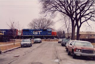 Northbound Grand trunk Western freight train passing through Chicago's Ashburn neighborhood. Febuary 1986.