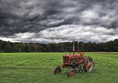 Tractor In A Storm (Bob Jagendorf) Tags: tractor storm field rain clouds farm colourartaward jagendorf