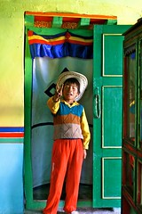 Tibetan Cowboy - and proud of it. (GigoloArt) Tags: boy colors kid cowboy colorful colours peace victory tibet independent tibetan peacesign lhasa victorysign 2470 cowboykid mywinners anawesomeshot colorphotoaward colourartaward theperfectphotographer goldstaraward goldstarward damniwishidtakenthat
