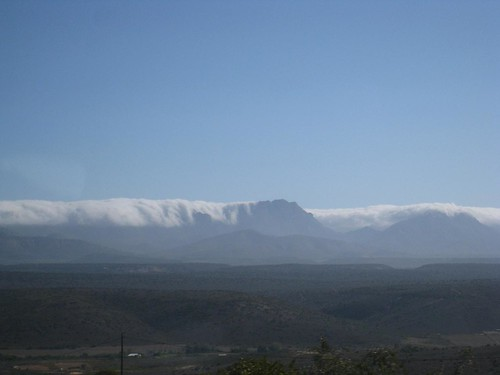Clouds float over the mountains near Outshorn