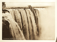 The Rainbow Fall from Livingstone Island, from Souvenir of Victoria Falls (Smithsonian Institution) Tags: africa tree nature water beauty waterfall high power natural spray huge zimbabwe victoriafalls majestic powerful magnificent zambia 1905 rushing smithsonianinstitution smithsonianinstitutionlibraries rainbowfall zambeziriver livingstoneisland thesmokethatthunders percymclark