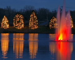 Reflections with a red fountain (Rick_28105) Tags: christmas landscape holidays tripod olympus nightscene nightimage christmastownusa mcadenvillenc e520 cpmg122108mcadenville
