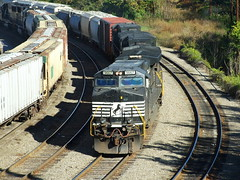 NS Inbound and outbound mixed merchandise freight trains meet in the middle of the railroad yard at Asheville, North Carolina, October 2007 (alcomike43) Tags: railroad yard train ties track diesel asheville ns engine rail locomotive ge southernrailway mainline ashevillenorthcarolina dieselelectriclocomotive norfolksouthernrailroad mixedmerchandisefreighttrain polishedrail