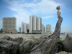 ....Portoverde.... (rebranca46) Tags: italy driftwood balance sassi 2009 ephemeral adriaticsea palazzi equilibrio rockbalancing portoverde rebranca