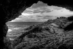 Kauai B&W HDR (NatashaBishop) Tags: ocean blue sea sky water beautiful clouds landscape island hawaii sand rocks aqua alone peace silent pacific rocky caves shore kauai tropical inlet cave hdr rugged secluded pitted relzx kauaiedit2