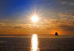 Keep on shining your light (vw4ross) Tags: blue sunset sky sun lighthouse water silhouette clouds reflections lakeerie starburst blueribbonwinner lorainlighthouse diamondclassphotographer