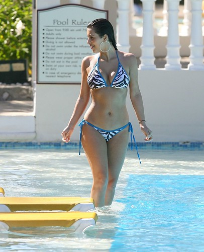 Kim Kardashian in two-piece bikini in a swimming pool