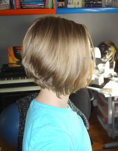 hairstyle long in front short in back. Shorter in the ack, longer in
