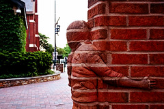 Life is an Open Book (Pankcho) Tags: sculpture usa art girl wall pared book nc kid arte charlotte bricks libro northcarolina nia escultura explore textures uptown camouflage embrace ladrillos mimic texturas abrazo wachovia thegreen camuflaje bricked mimetizar