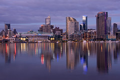 Melbourne, reflections of a city (tim.mcrae) Tags: city blue windows sunset red cloud colour night reflections mirror evening town skyscrapers harbour australia melbourne victoria telstra dome docklands cbd rialto