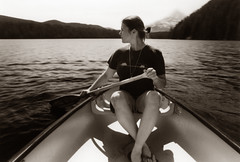 self portrait: the slow spin of a lost lake (manyfires) Tags: mountain lake selfportrait film me water sepia oregon paddle canoe mthood pacificnorthwest lostlake nikonfm 500px whichisprettymuchhowitalwaysendsup weirdhalfponytailhalfbuninmyhair