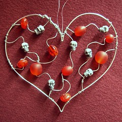 Red Skully Heart - a suncatcher in beads and steel wire