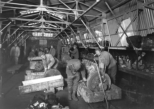 Chinese mechanics, from the 51st Chinese Labour Company, repairing British tank engines at Teneur, France, during the First World War
