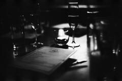 everybody knows (except you) (hurtingbombz) Tags: classic menu table hongkong lowlight shadows wine f14 champagne voigtlander bessa mc 40mm r3a nokton pressroom expiredfilm fujifilmneopan1600 myfavedivinecomedysong