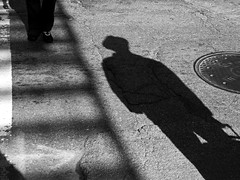 The Visitor (an untrained eye) Tags: shadow chicago man hat topv111 illinois topv555 topv333 unitedstates loop streetphotography topv222 bandw interestingness43 utatafeature anuntrainedeye 2bdasest explore07nov08