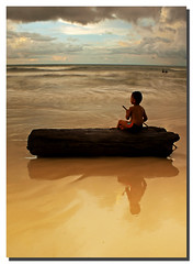 Kid at the Beach (Nora Carol) Tags: reflection beach waves sony kotakinabalu a200 sabah malaysianphotographer picswithframes noracarol sabahanphotographer landscapephotographerfromsabah womanlandscapephotographer womaninphotography