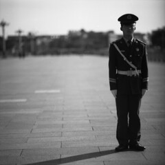 tian'anmen (memetic) Tags: china street shadow portrait bw man 6x6 square asian soldier army blackwhite alone bokeh tmax chinese beijing 100  superfantastique prc  solitary tiananmen arax60