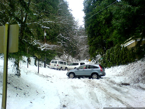 vehicles in various states of distress - two stuck and one abandoned - at the turn-off to our house - DSC02243