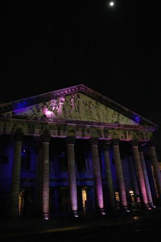 Theater with purple lights under a Tsok Kor Moon, Guadalajara public square, Jalisco, Mexico by Wonderlane