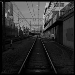 (gullevek) Tags: blackandwhite 6x6 japan geotagged iso100 tokyo traintracks bronica wires electricity   ilford   bronicasqai ilforddelta100pro epsongtx900 thegoodcollection zenzabronicasqai zenzanonps80mmf28 geo:lat=35683065 geo:lon=139702771