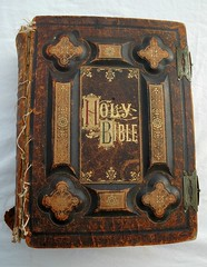 Holy Bible, dated 1885, antique gold lettering, leather and board, held together with dental floss (Wonderlane) Tags: seattle old history leather paper word mexico book catholic antique gothic christian holy story photograph american creativecommons westseattle record bible puertovallarta washingtonstate printed binding protestant embossed engraved steampunk holybible theholybible wonderlane 0046 goldlettering metalclasps printedbook madein1885 dated1885