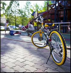 Yellow bicycle (yein~) Tags: 120 6x6 tlr bicycle playground yellow rolleiflex mediumformat square fuji reala100 40fw