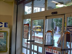 A view out of the Walgreen's Drug Store window of an approaching Memphis Main Street trolley car. Memphis Tennesee. September 2007.