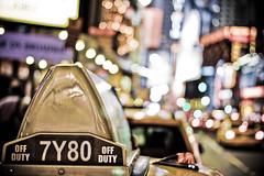 Taxi light in colors, Times Square @ New York City, USA (Doudou) Tags: street nyc newyorkcity trip travel urban usa ny newyork building apple america canon interestingness big dof artistic bokeh manhattan cab taxi american timessquare fav conceptual 400d