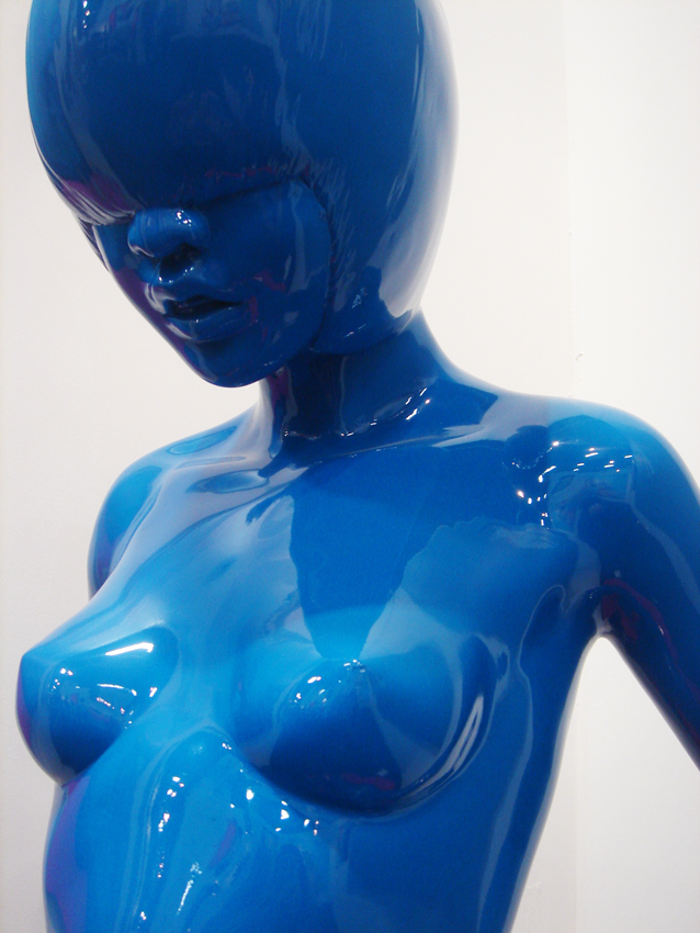 blue plastic girl sculpture