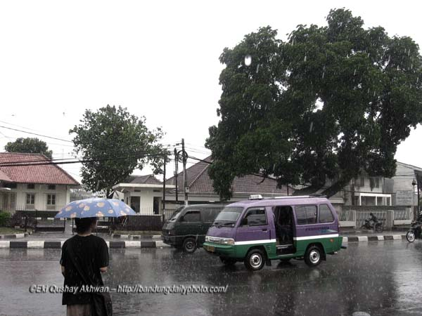 WAITING FOR THE ANGKOT IN THE RAIN