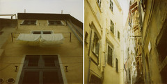 hung out to dry (:lynn:) Tags: italy sunshine yellow polaroid alleyway cinqueterre clotheslines vernazza polaroid680 washlines twonakedpolaroids