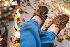 I want it to be fall forever. (Amanda) Tags: november sunlight fall film feet nature colors girl leaves shoes autum bokeh fallcolors deadleaves hippie nikonfe minnetonka crossedlegs moccasins