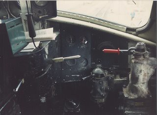 The cab of a Metra, EMD model E-8 passenger locomotive. Harvard Illinois. Saturday, October 28th 1989.