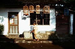 birdcages (khaniv13) Tags: street light shadow people house film birdcage indonesia random traditional scene nikonf100 yogyakarta kotagede fujiproplus100 khaniv13 af1835mmed